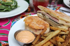 Pork Cubano sandwich, with Slow-Roasted Pork, Ham, Swiss Cheese and Mojo Sauce( lunch only)